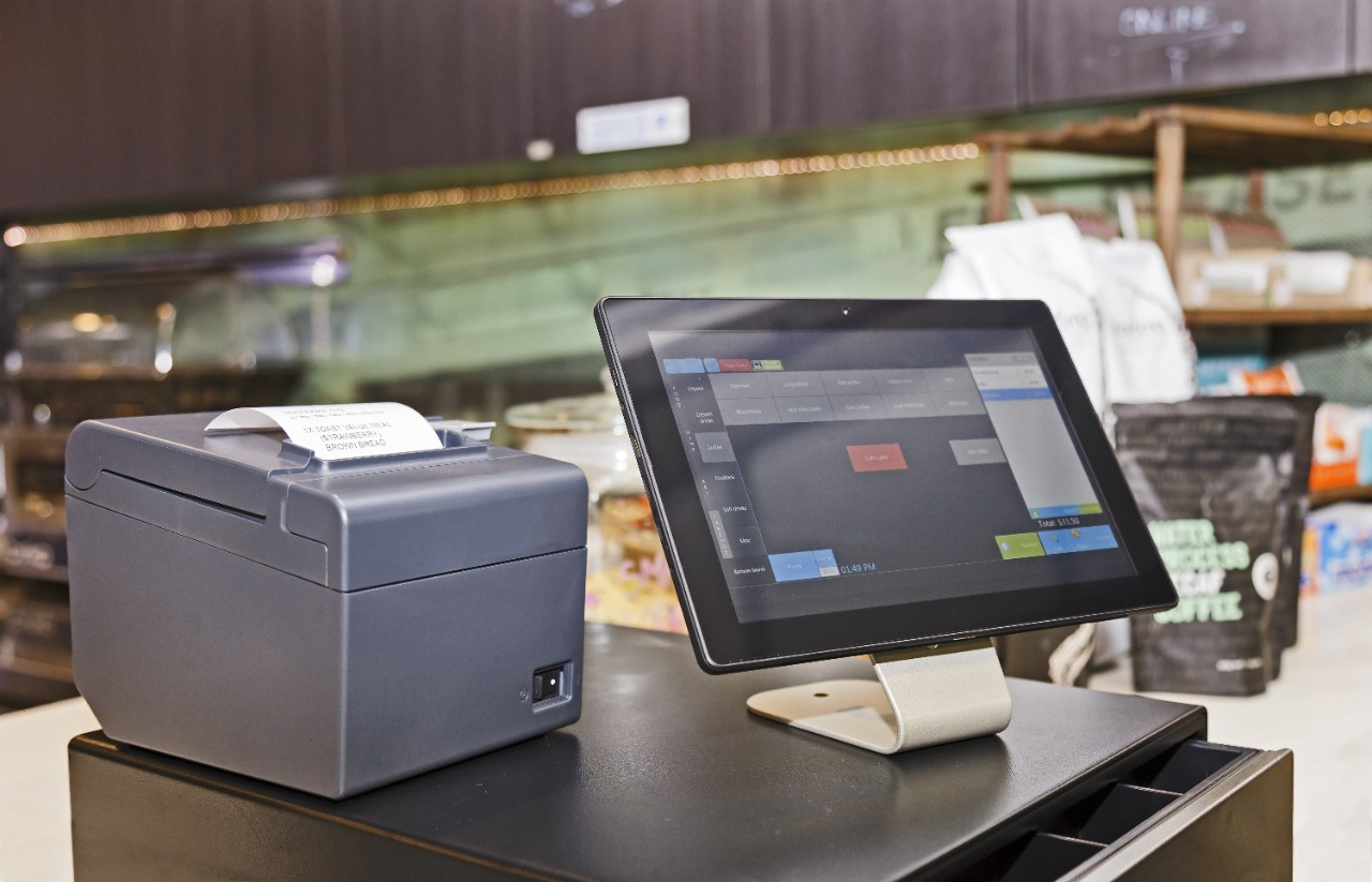 Point of Sale retail service computerised terminal in coffee shop. Touch screen tablet based with software interface for waiters with cash register and mobile print terminal.; Shutterstock ID 581306539